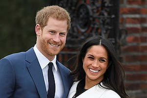 Britain's Prince Harry poses with his fiancée, U.S. actress Meghan Markle, at the Sunken Garden at Kensington Palace in London following Monday's formal announcement of their engagement.