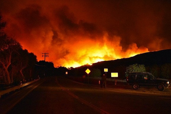 Burning with extreme speed and ferocity, a flurry of wildfires torched more than 65,000 acres in Southern California, as firefighters ...