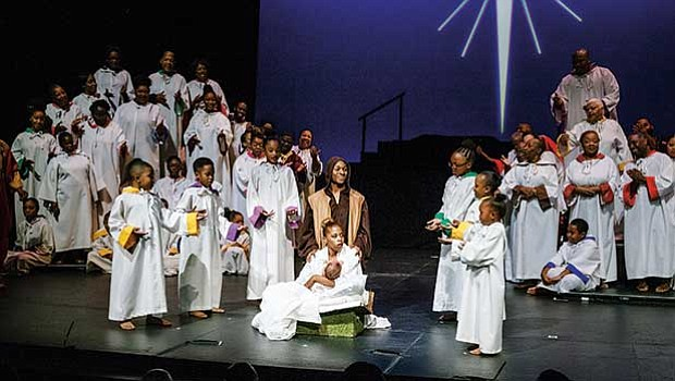 "The Children of Black Persuasion perform the song ""Mary, Mary, What You Gonna' Name Your Baby"" around Kaleisha Chance as Mary and Derrick Louizia as Joseph."