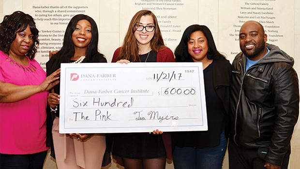 "Tia Myers, CEO of T.M. Gallery Photography created ""The Pink"" fashion show to raise money for Breast Cancer and the proceeds were donated to Dana – Farber/Jimmy Fund. Myers presented the check to Megan Ingram, the representative of Dana-Farber/Jimmy Fund. (left-right) Donna Jules, Ayanna O'Brien, Ingram, Myers and Steve Lissaint."