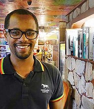 Farmer's House Coffee owner Kassegn Sirmollo uses beans from Ethiopia in the coffee he serves in his Boston cafe.