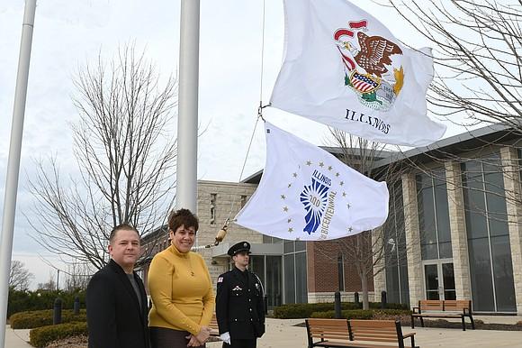 Romeoville Mayor Noak, along with State Senator Jennifer Bertino-Tarrant, raised Illinois' bicentennial flag at village hall this week.