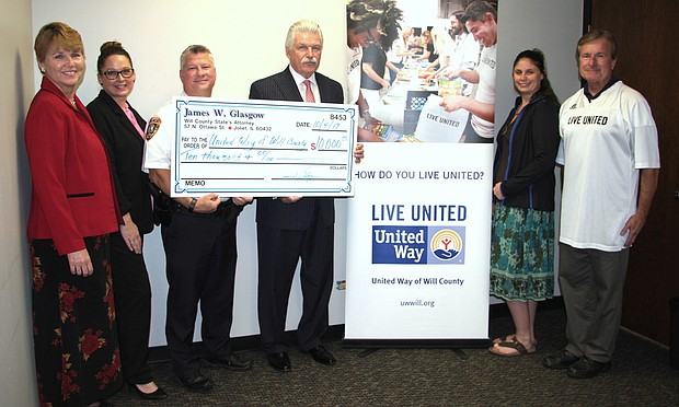 United Way's Laurie Keigher and Sarah Oprzedek (from left); United Way Board Member/Joliet Police Chief Brian Benton; State's Attorney Glasgow; Loren Yaksich and United Way CEO Michael Hennessy.