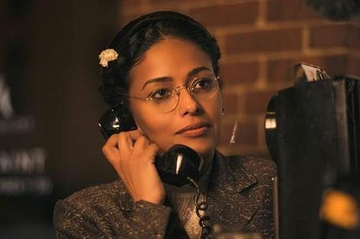 In a scene from TV One's 'Behind the Movement,' Rosa (Golding) is finally allowed to make her one phone call to let her husband know she's in jail (photo via TV One)