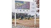 A sign offers the vision of the planned Church Hill North development that now needs a $4.9 million bailout from City Council. Heavy machinery prepares the land in the 1600 block of North 31st Street for the proposed construction of new apartments and homes on the site of the old Armstrong High School.