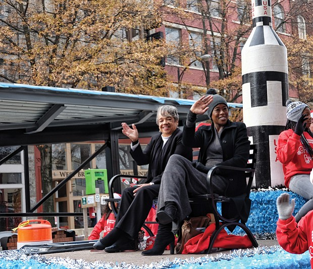 "Welcoming Christmas on parade // Margot Lee Shetterly, author of the book ""Hidden Figures"" about NASA's pioneering women, wave to the crowd."