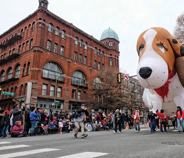 Welcoming Christmas on parade // There's nothing like a parade to get into the holiday spirit. Thousands of people lined Broad Street from the Science Museum to 7th Street in Downtown for the 34th Annual Dominion Energy Christmas Parade last Saturday. Floats included big inflatables, such as this giant puppy balloon, right, that was guided down the street by a bevy of volunteers. The day wasn't just for the young. Middle left, adults and seniors cheered and dance on the sidelines as marching bands and cheerleading units pass by. Middle right, grand marshals of this year's parade, retired NASA mathematician and aeronautical engineer Christine Darden,