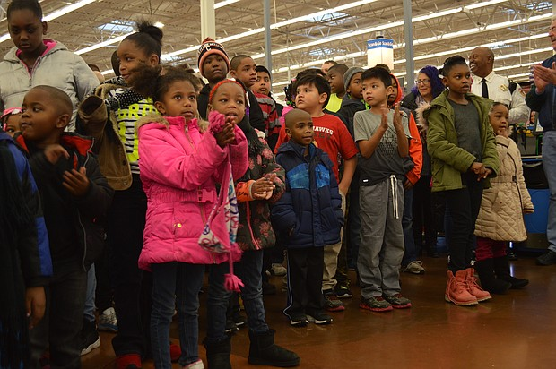 Children wait to pair up with a Joliet Police officer for the Santa Cops program.