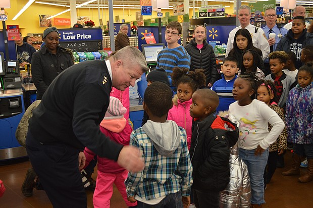 Joliet Police Chief Brian Benton talks to kids before the start of the department's 29th annual Santa Cops program.
