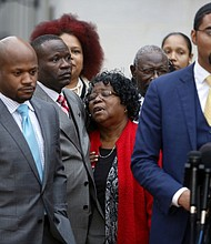 In this Monday, Dec. 5, 2016, file photo, Judy Scott, center, Walter Scott's mother, is comforted by her son Rodney Scott, as the family attorneys, Chris Stewart, left, and Justin Bamberg, right, hold a press conference after a mistrial was declared in former South Carolina officer, Michael Slager's trial in Charleston, S.C. (AP Photo/Mic Smith, File)