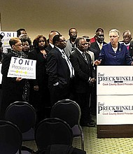 Clergy members from Cook County stood behind Toni Preckwinkle, Cook County Board President, as she spoke at the Lake Shore Cafe on Dec. 7. The religious community members were in attendance to show their support for the Preckwinkle re-election campaign. Photo Credit: Katherine Newman