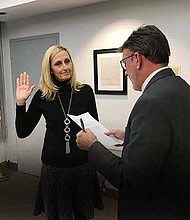 Vivian Payne, the newest member of South Suburban College Board of Trustees is sworn in by Vice President of Administration Martin Lareau. Photo Credit: South Suburban College