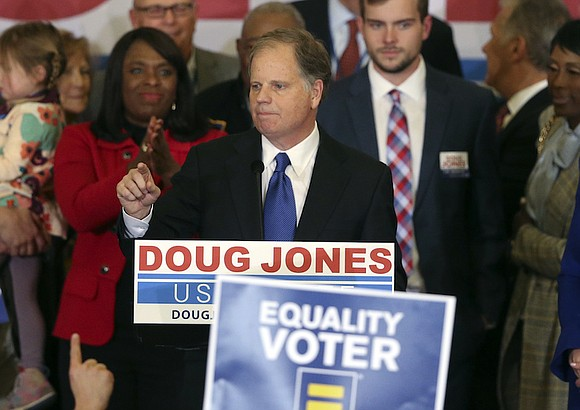 In a stunning victory aided by scandal, Democrat Doug Jones won Alabama's special Senate election, beating back history, an embattled ...