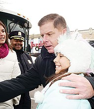 Mayor Martin Walsh meets and greets residents and leads the countdown to light the Christmas tree in Codman Square, Dorchester during the Mayor's Trolley tour through the neighborhoods of Boston.