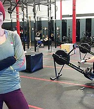 CrossFit Boston Iron & Grit owner and founder Tina Ramos coaches clients in her West Roxbury gym and works with local teens through her nonprofit.