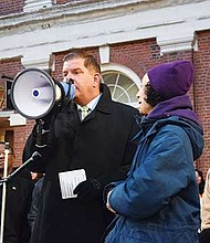 Mayor Martin Walsh addresses the crowd on National Day of Action