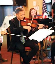 A youngster serves as guest conductor for Unitas Ensemble.