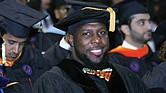 Charlottesville Vice Mayor Wes Bellamy receives his doctorate at Sunday's ceremony, where VSU conferred degrees on 306 graduates.