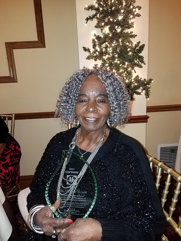 Margie Woods received the ICON award from the Joliet Chapter of the National Hookup of Black Women on Saturday at the group's annual Founder's Day fundraiser.