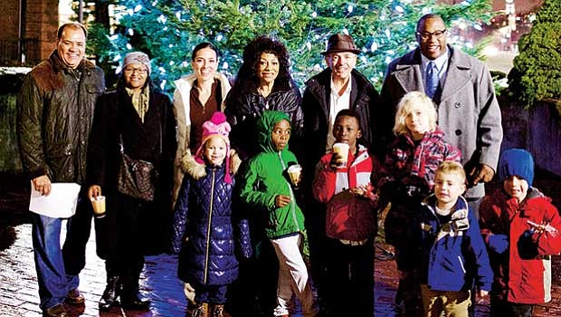 Members of the Roxbury community joined together to celebrate Cruz Companies' 32nd Annual Holiday Tree Lighting Ceremony at the Cox Building this week (l-r) Dan Cruz, Jr. Sr. VP, Cruz Companies; Candice Sealy, district rep. for Congressman Capuano; Sen. Sonia Chang-Diaz; Barbara Cruz; John B. Cruz, III, president, Cruz Companies; City Councilor Tito Jackson, and Roxbury community youth.