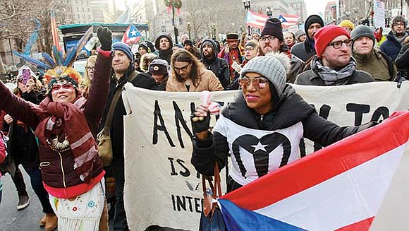 More than 100 people on Sunday marched from the South End's Villa Victoria down Dartmouth Street and to Copley Square ...