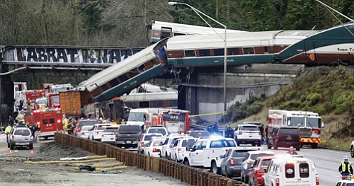 The Amtrak train bound for Portland and Seattle making its first ever run along a faster new route was hurtling ...