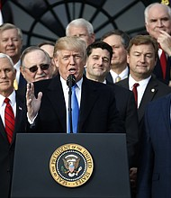 President Donald Trump speaks during a bill passage event on the South Lawn of the White House in Washington, Wednesday, Dec. 20, 2017, to acknowledge the final passage of tax overhaul legislation by congress. (AP Photo/Carolyn Kaster)