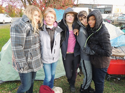 A homeless group of mostly women finds mutual support and camaraderie to survive the hardships of winter as they fight to survive the cold at a makeshift campsite along a highway in northeast Portland.