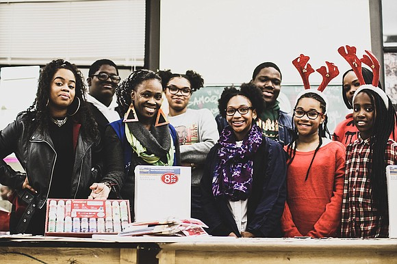 James A. Smith founder and CEO of Smith Brand Agency and Joseph Belony brought some holiday cheer to 300 students ...