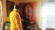 Fitz-Gerald displays one of his works in his Fitchburg home.