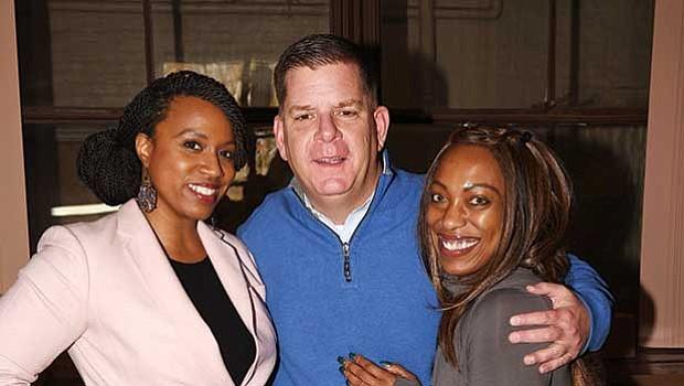 At-large City Councilor Ayanna Pressley, Mayor Martin Walsh and Dacia Tamara Shillingford-Compas took a break at the Mattapan Food Pantry during the annual holiday food basket giveaway.