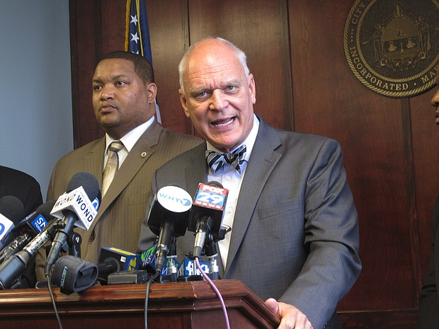 In this May 2, 2016 photo, Atlantic City Councilman Marty Small, left, and Mayor Don Guardian, right, speak at a press conference in Atlantic City N.J. about its efforts to fight off a proposed state takeover. The state did seize power in Atlantic City later in 2016, and Guardian lost a re-election bid last month. He will begin his new job as town administrator for Toms River next month. (AP Photo/Wayne Parry)