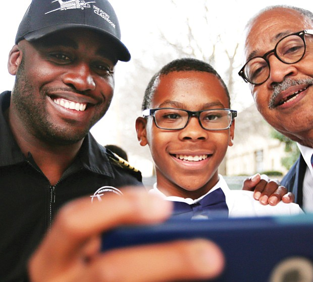 Student Nick Booker, center, takes a selfie with aviator Barrington Irving, left, and Douglass School Dean Elbert Brinson after Mr. Irving's February talk at the Science Museum of Virginia.