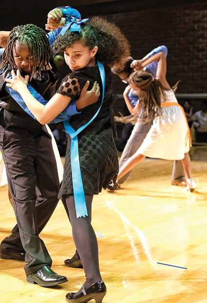 Julius Jackson, left, and Tristan Albers of Chimborazo Elementary School perform the tango at the Dancing Classrooms GRVA Colors of the Rainbow Team Match in April.
