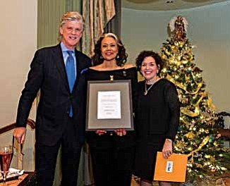 Michelle Flowers Welch, founder and CEO of Flowers Communications Group, accepts the 2017 Distinguished Senior Leader Award by the Public Relations Society of America Chicago Chapter alongside event co-chairs Rich Jernstedt, CEO of The Jernstedt Company and Bridget Coffing, formerly of McDonald's.