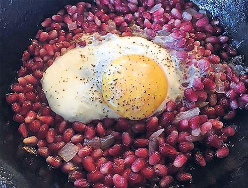 Narnumru is a fried egg atop fried pomegranate arils.
