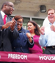 City Councilor Tito Jackson and Mayor Martin Walsh strike a conciliatory pose during a ribbon cutting.
