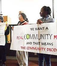 Demonstrators at a Nov. 29 BPDA planning meeting for Glover's Corner.