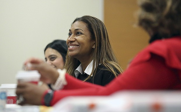 Letitia Plummer, a Houston dentist and candidate for Congress to represent Texas District 22, smiles during a women's candidate training workshop at El Centro College in Dallas. (AP Photo/LM Otero)