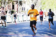 Mayor Stoney, a former high school track and football star, takes part in the Monument Avenue 10K last April.