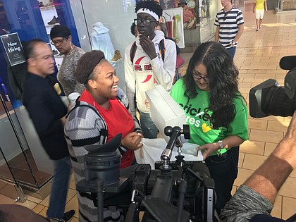 YES Prep student Davenese Bailey is all smiles during a surprise holiday shopping spree at The Galleria.