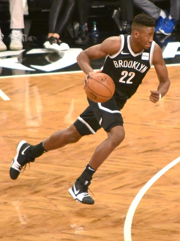 Caris LeVert lays up 6-foot-9, 255-pound center Bismack Biyombo, on the right side of Brooklyn's basket.