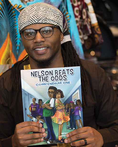 Author Ronnie Sidney, a licensed clinical social worker, displays one of his children's books at the festival marketplace