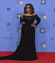 Oprah Winfrey poses in the press room with the Cecil B. DeMille Award at the 75th annual Golden Globe Awards at the Beverly Hilton Hotel on Sunday, Jan. 7, 2018, in Beverly Hills, Calif. (Photo by Jordan Strauss/Invision/AP)