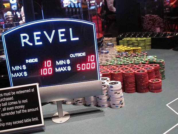 In this May 21, 2012 photo, stacks of chips sit on a gambling table at the former Revel casino in Atlantic City N.J. On Monday Jan. 8, 2018, Colorado developer Bruce Deifik announced he has bought the shuttered casino from Straub for $200 million, and plans to reopen it in summer 2018. (AP Photo/Wayne Parry)