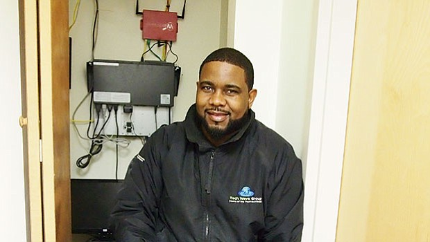 Ryan Brathwaite, CEO and president of Tech Wave Group, on the job at a client site.