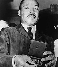 Martin Luther King, Jr. with his Nobel Prize.