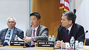 Members of the appointed school committee, Vice Chairman Hardin Coleman and former Chairman Michael O'Neill, listen to a presentation by BPS Superintendent Tommy Chang.
