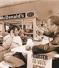 Nate Proby of United Minority Workers administers an oath to Francis Newman during a voters registration drive in 1972 at the former McDonalds restaurant at Northeast Martin Luther King Jr. Boulevard and Fremont Street.
