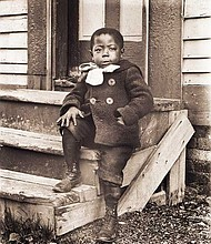 """""""Ralph Mendis on a Stoop,"""" photographed by William Bullard about 1902; printed 2016, archival inkjet print on Epson Hot Press Natural paper; facsimile produced from glass plate negatives lent by Frank J. Morrill."""